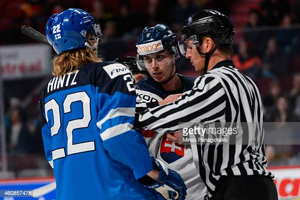 Patrik Bacik of Team Slovakia has some words for Roope Hintz of Team Finland during the 2015 IIHF World Junior Hockey Championship game at the Bell...