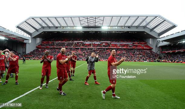 Patrik Berger Dirk Kuyt and Vladimir Smicer of Liverpool FC Legends showing his appreciation to the fans at the end of the friendly match between...