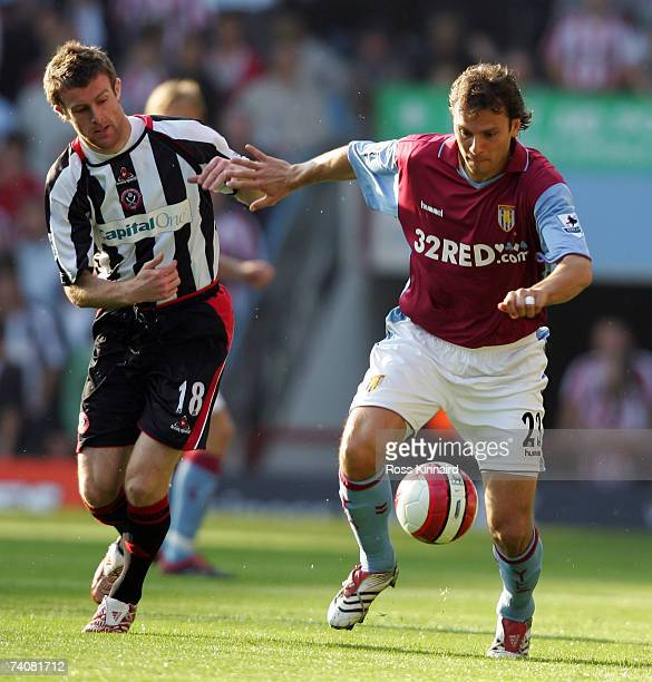 Patrik Berger of Villa is challenged by Michael Tonge of Sheffield during the Barclays Premiership match between Aston Villa and Sheffield United at...