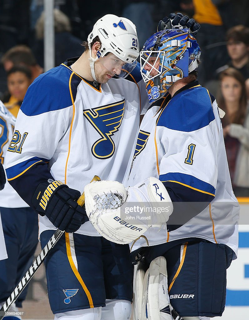Patrik Berglund #21 congratulates goalie Brian Elliott #1 of the St. Louis Blues after defeating the Nashville Predators in a shootout during an NHL game at the Bridgestone Arena on January 21, 2013 in Nashville, Tennessee.