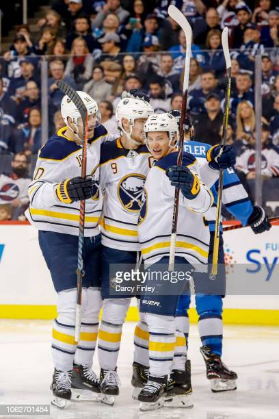 Patrik Berglund Jack Eichel and Jeff Skinner of the Buffalo Sabres celebrate a third period goal against the Winnipeg Jets at the Bell MTS Place on...