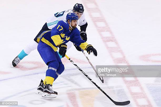 Patrik Berglund of Team Sweden is defended by Leon Draisaitl of Team Europe during the third period at the semifinal game during the World Cup of...