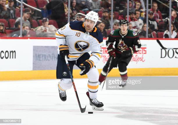 Patrik Berglund of the Buffalo Sabres advances the puck up ice against the Arizona Coyotes during the first period at Gila River Arena on October 13...
