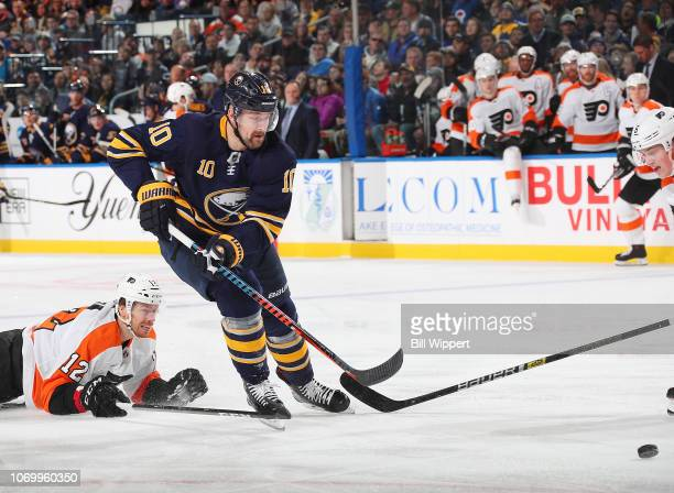 Patrik Berglund of the Buffalo Sabres is defended by Michael Raffl of the Philadelphia Flyers during an NHL game on December 8 2018 at KeyBank Center...