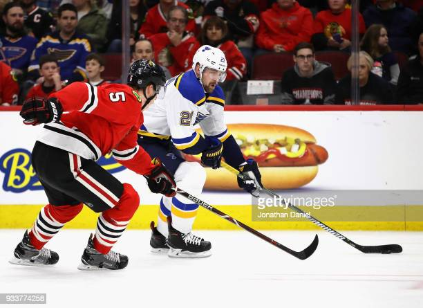 Patrik Berglund of the St Louis Blues advances the puck under pressure from Connor Murphy of the Chicago Blackhawks at the United Center on March 18...