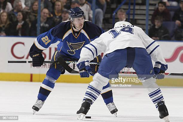 Patrik Berglund of the St Louis Blues and Wayne Primeau of the Toronto Maple Leafs wait for a face off on February 12 2010 at Scottrade Center in St...