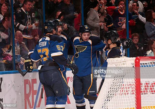 Patrik Berglund of the St Louis Blues celebrates his goal with teammates David Perron Vladimir Tarasenko and Andy McDonald in an NHL game against the...