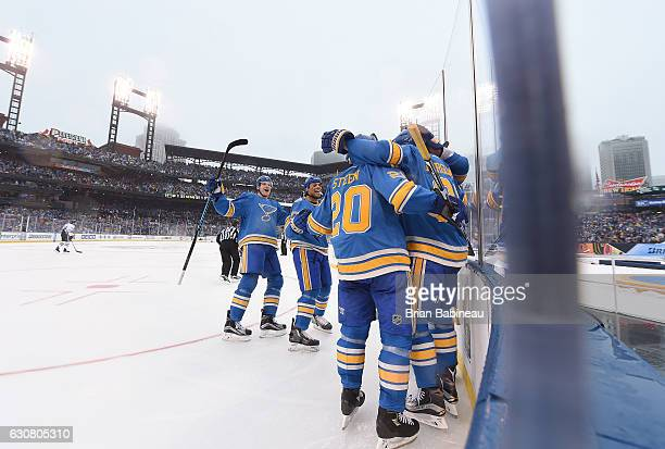 Patrik Berglund of the St. Louis Blues celebrates with teammates Colton Parayko, Ryan Reaves, and Alexander Steen after scoring in the second period...