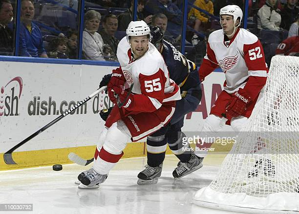 Patrik Berglund of the St Louis Blues controls the puck in between Niklas Kronwall and Jonathan Ericsson of the Detroit Red Wings in an NHL game on...