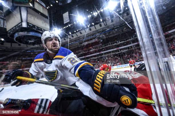 Patrik Berglund of the St Louis Blues gets physical by the glass in the second period against the Chicago Blackhawks at the United Center on April 6...