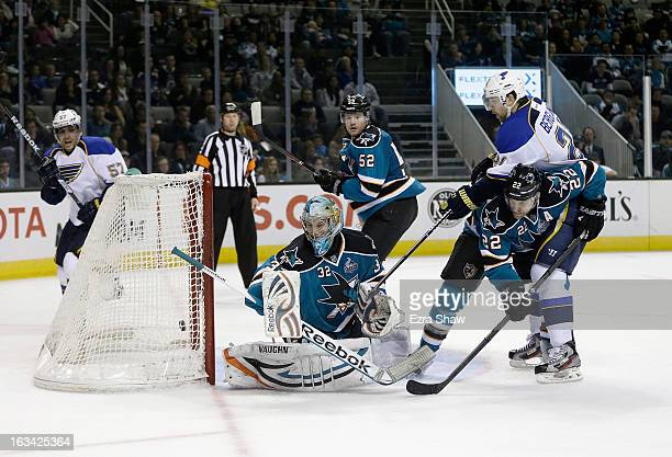 Patrik Berglund of the St Louis Blues gets the puck past Dan Boyle and goalie Alex Stalock of the San Jose Sharks to score the gamewinning goal in...