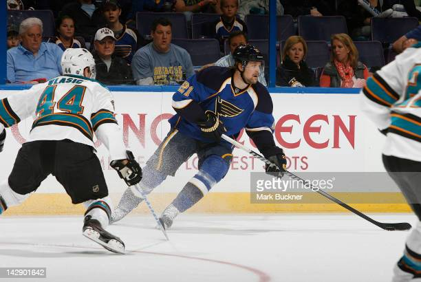 Patrik Berglund of the St Louis Blues handles the puck as MarcEdouard Vlasic of the San Jose Sharks defends in Game Two of the Western Conference...