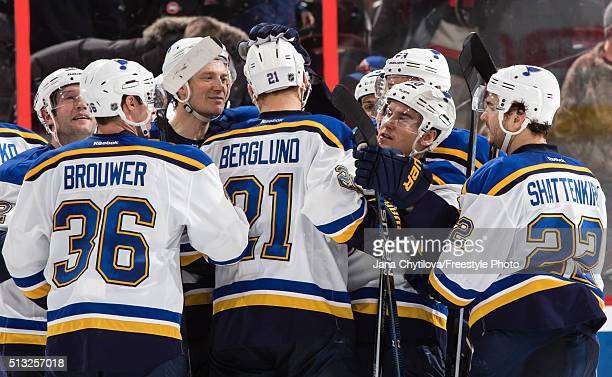 Patrik Berglund of the St Louis Blues is surrounded by team mates Troy Brouwer Jay Bouwmeester Scottie Upshall and Kevin Shattenkirk after scoring...
