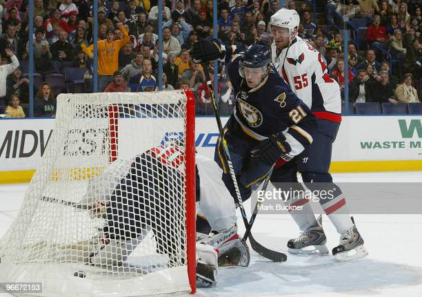 Patrik Berglund of the St Louis Blues scores a goal on Jose Theodore of the Washington Capitals in front of Jeff Schultz on February 13 2010 at...
