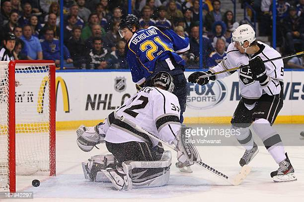 Patrik Berglund of the St Louis Blues scores the gametying goal against Jonathan Quick and Keaton Ellerby of the Los Angeles Kings in Game Two of the...
