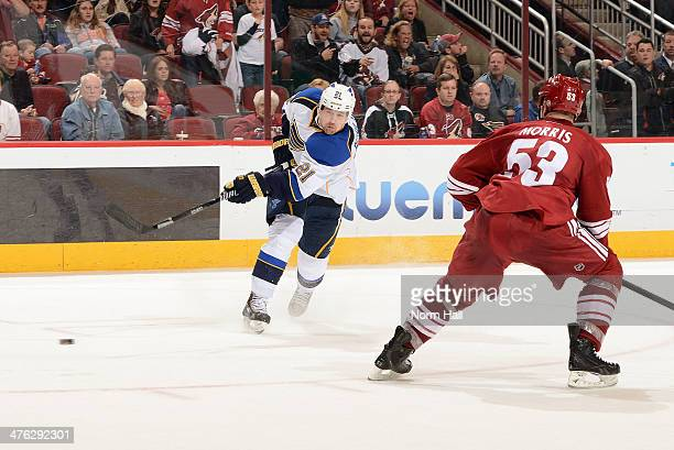 Patrik Berglund the St Louis Blues fires the puck on net past Derek Morris of the Phoenix Coyotes at Jobing.com Arena on March 2, 2014 in Glendale,...