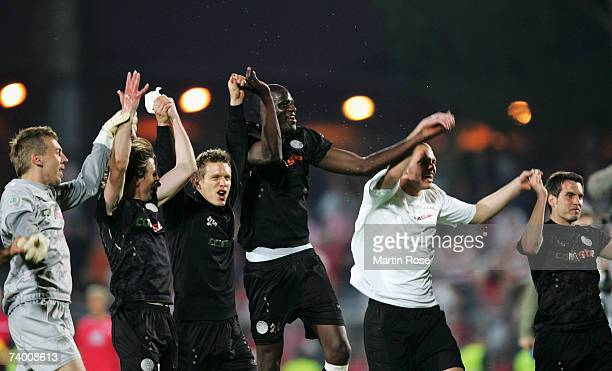Patrik Borger, Daniel Stndel, Marvin Braun, Morike Sako, Benedikt Pliquett and Thomas Meggle of St.Pauli celebrate with the fans during the Third...