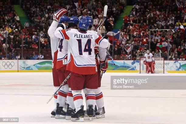 Patrik Elias of the Czech Republic and his teammates react after his first period goal against Slovakia during the ice hockey men's preliminary game...