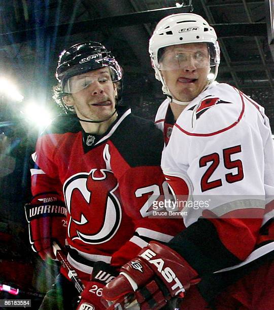 Patrik Elias of the New Jersey Devils and Joni Pitkanen of the Carolina Hurricanes battle during Game Two of the Eastern Conference Quarterfinal...