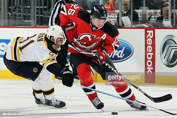 Patrik Elias of the New Jersey Devils carries the puck against Miroslav Satan of the Boston Bruins at the Prudential Center on March 30 2010 in...