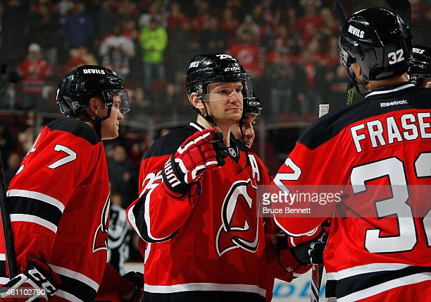 Patrik Elias of the New Jersey Devils celebrates a 41 victory over the Buffalo Sabres at the Prudential Center on January 6 2015 in Newark New Jersey...