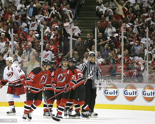 Patrik Elias of the New Jersey Devils celebrates with teammates after his goal against the Carolina Hurricanes during the second period of game three...