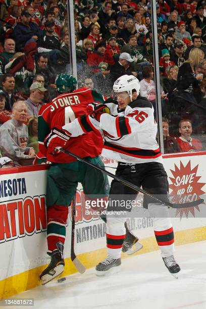 Patrik Elias of the New Jersey Devils checks Clayton Stoner of the Minnesota Wild during the game at the Xcel Energy Center on December 2 2011 in St...