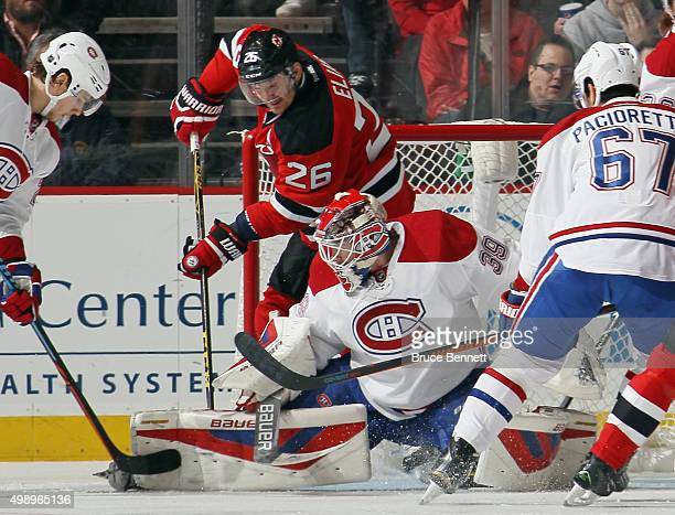 Patrik Elias of the New Jersey Devils gets in behind Mike Condon of the Montreal Canadiens during the first period at the Prudential Center on...