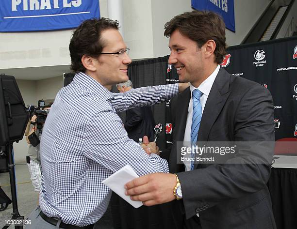 Patrik Elias of the New Jersey Devils greets Ilya Kovalchuk following a media opportunity announcing his contract renewal at the Prudential Center on...