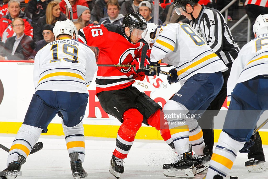 Patrik Elias #26 of the New Jersey Devils in action against Chris Stewart #80 of the Buffalo Sabres at the Prudential Center on February 17, 2015 in Newark, New Jersey. The Devils defeated the Sabres 2-1 after a shootout.