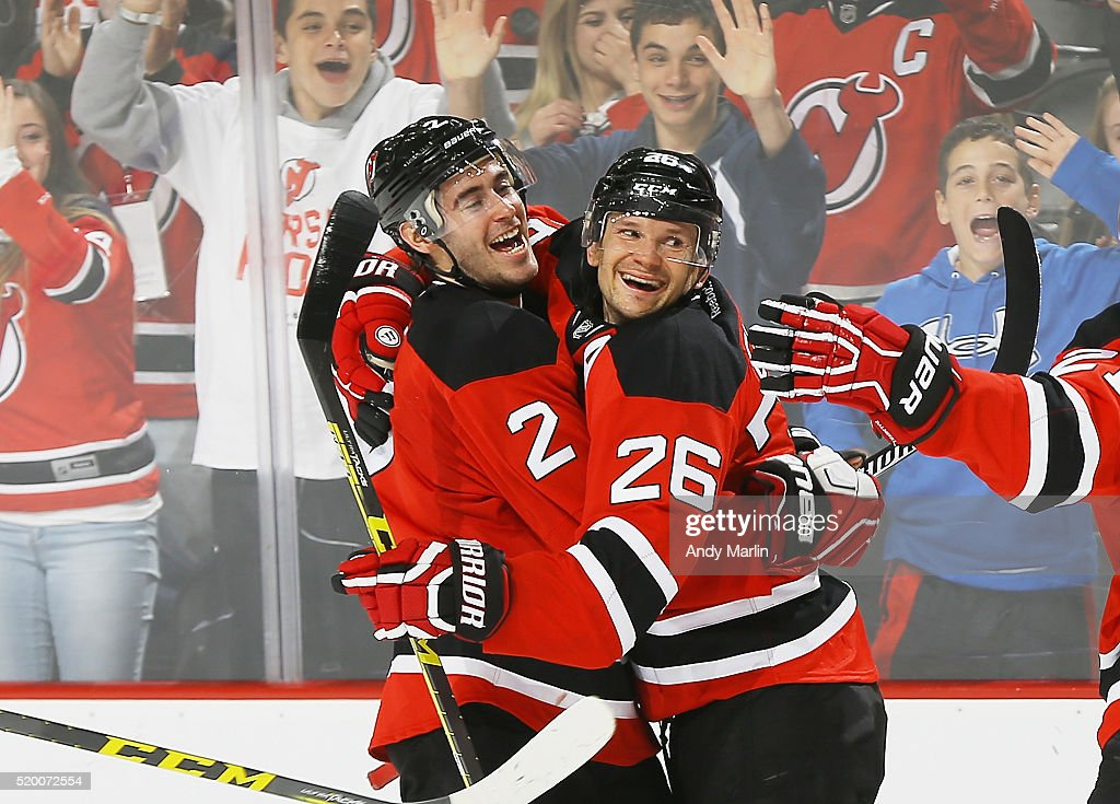 Patrik Elias #26 of the New Jersey Devils is congratulated by John Moore #2 after scoring a goal against the Toronto Maple Leafs during the game at Prudential Center on April 9, 2016 in Newark, New Jersey.