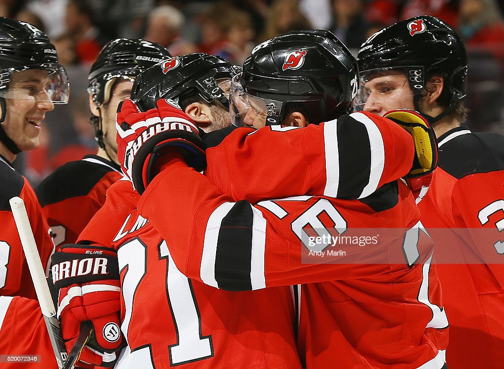 Patrik Elias #26 of the New Jersey Devils is congratulated by Kyle Palmieri #21after scoring a goal against the Toronto Maple Leafs during the game at Prudential Center on April 9, 2016 in Newark, New Jersey.