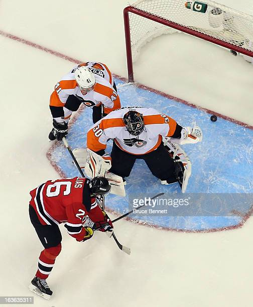 Patrik Elias of the New Jersey Devils opens the scoring at 202 of the first period against Ilya Bryzgalov of the Philadelphia Flyers at the...