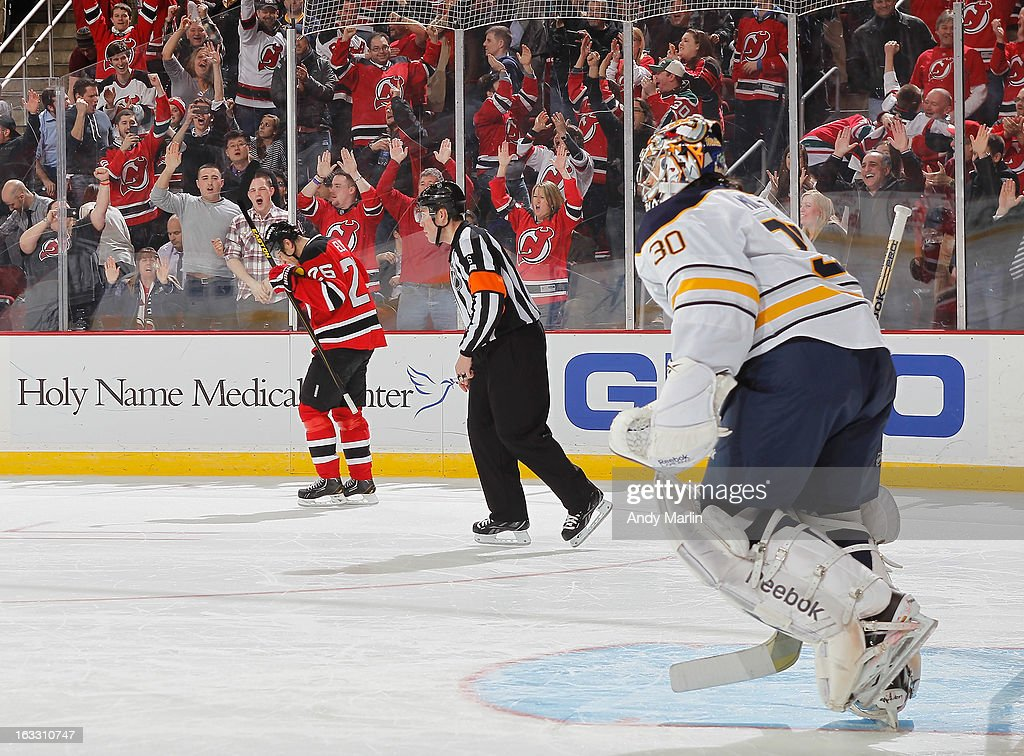Patrik Elias #26 of the New Jersey Devils reacts after scoring the game deciding goal in the shootout as Ryan Miller #30 of the Buffalo Sabres skates away during the game at the Prudential Center on March 7, 2013 in Newark, New Jersey.