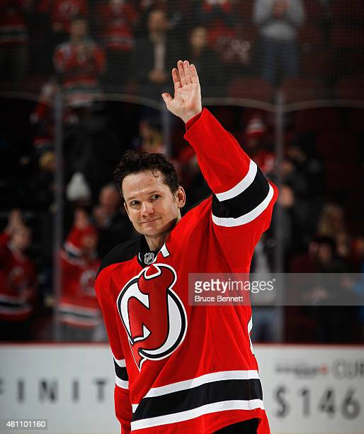 Patrik Elias of the New Jersey Devils salutes the crowd following a 41 victory over the Buffalo Sabres at the Prudential Center on January 6 2015 in...