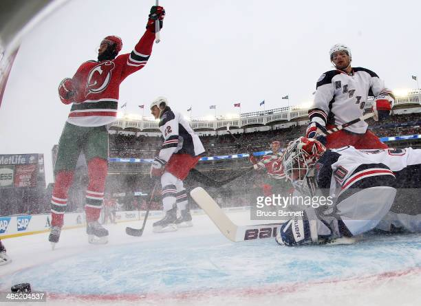 Patrik Elias of the New Jersey Devils scores a first period goal against Henrik Lundqvist of the New York Rangers during the 2014 Coors Light NHL...
