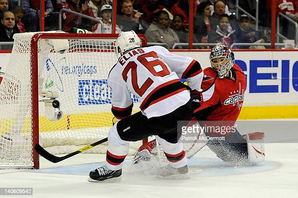 Patrik Elias of the New Jersey Devils scores a goal against Michal Neuvirth of the Washington Capitals during the second period at Verizon Center on...
