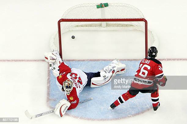 Patrik Elias of the New Jersey Devils scores a goal on Tomas Vokoun of the Florida Panthers play during the second period on November 20 2008 at the...
