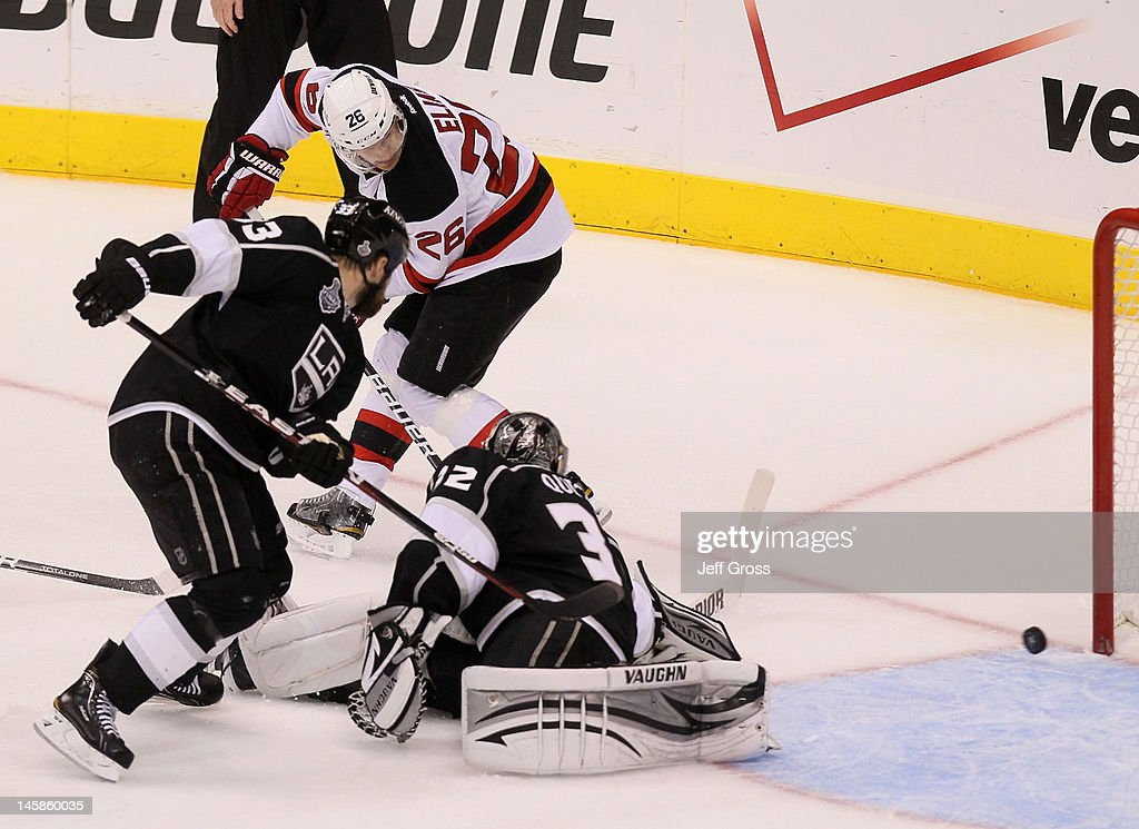 Patrik Elias #26 of the New Jersey Devils scores a goal over Willie Mitchell #33 and goaltender Dustin Brown #23 of the Los Angeles Kings in the third period of Game Four of the 2012 Stanley Cup Final at Staples Center on June 6, 2012 in Los Angeles, California.