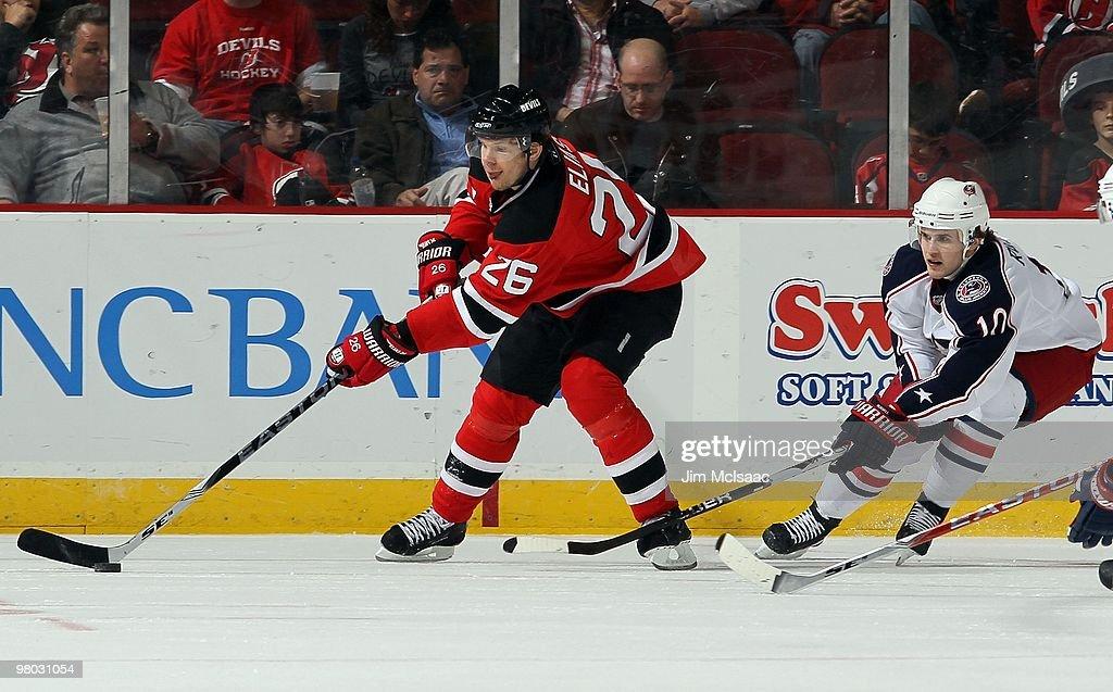 watch 66ad0 ab59d Patrik Elias of the New Jersey Devils skates against Kris ...