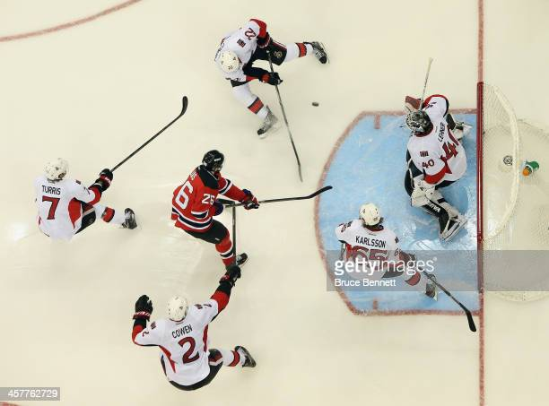 Patrik Elias of the New Jersey Devils skates in against the Ottawa Senators at the Prudential Center on December 18 2013 in Newark New Jersey The...