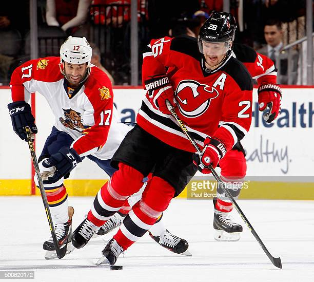 09a26097667 Patrik Elias of the New Jersey Devils skates past Derek MacKenzie of the Florida  Panthers during