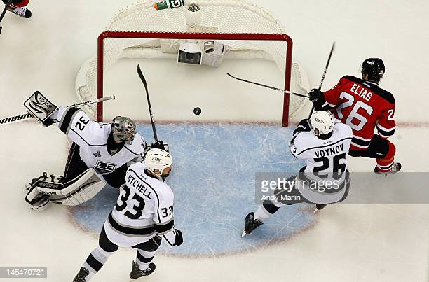 Patrik Elias of the New Jersey Devils watches the puck into the net on a goal by Anton Volchenkov against the Los Angeles Kings in Game One of the...