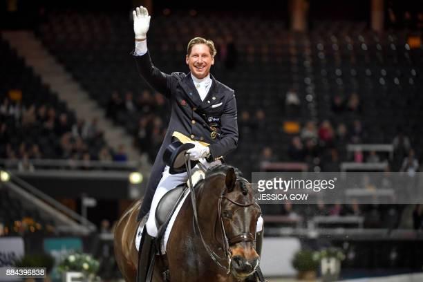 Patrik Kittel of Sweden celebrates on his horse Deja during the FEI Grand Prix dressage qualifying event at the Sweden International Horse Show on...