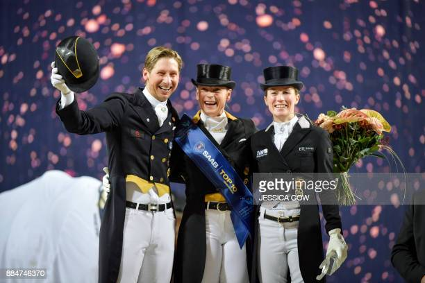 Patrik Kittel of Sweden Isabell Werth of Germany and Helen Langehanenberg of Germany pose during the award ceremony after the FEI Grand Prix...