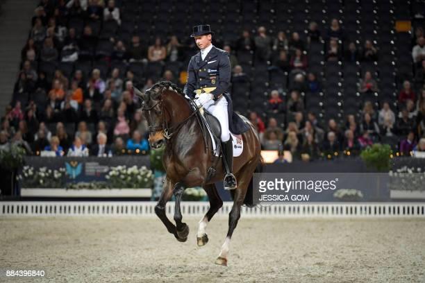 Patrik Kittel of Sweden rides his horse Deja during the FEI Grand Prix dressage qualifying event at the Sweden International Horse Show on December 2...