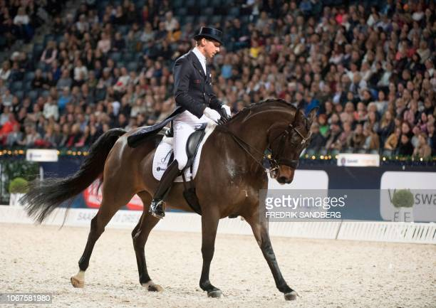Patrik Kittel of Sweden rides his horse Delaunay Old during the Grand Prix dressage freestyle event at Sweden international horse show at the Friends...