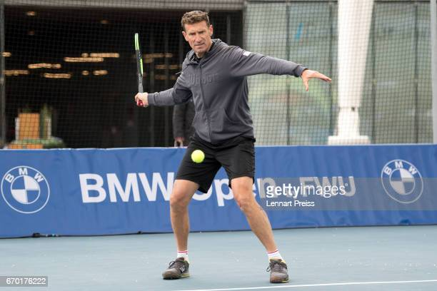 Patrik Kuehnen tournament director BMW Open plays a forehand during the BMW Open Show Match at Airport Munich on April 19 2017 in Munich Germany