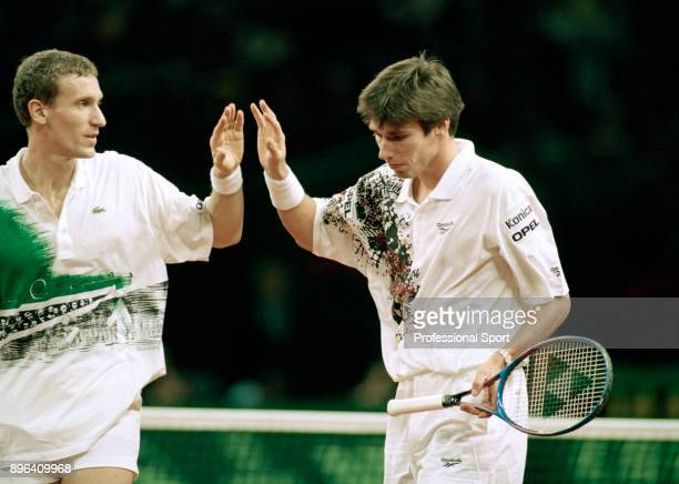 Patrik Kuhnen and Michael Stich of Germany high five during their doubles match against Todd Woodbridge and Mark Woodforde of Australia during the...