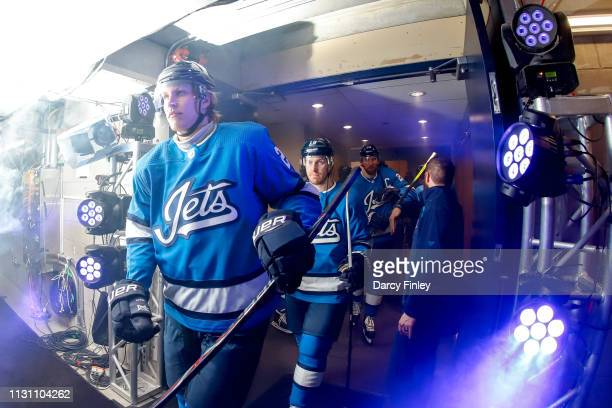 Patrik Laine and Bryan Little of the Winnipeg Jets head to the ice prior to puck drop against the Calgary Flames at the Bell MTS Place on March 16...